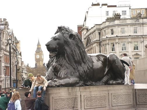 Trafalgar Square lion with Big Ben Tower in distance