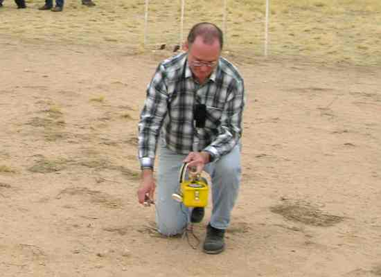 Using a geiger counter at Trinity Site Ground Zero