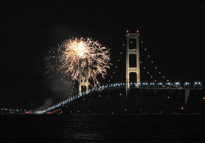 Mackinac Bridge at night with fireworks