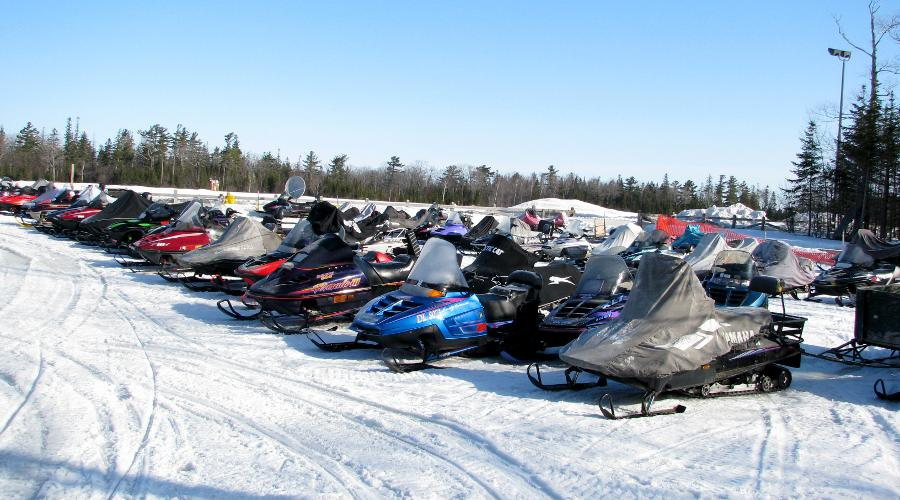Snowmobiles parked at the Mackinac Island airport.