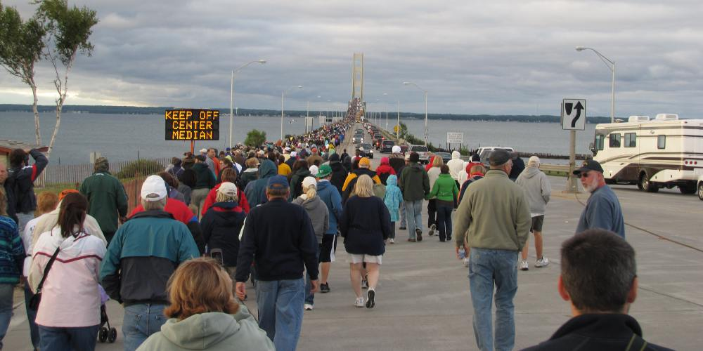 Walkers at the foot of the Mackinac Bridge