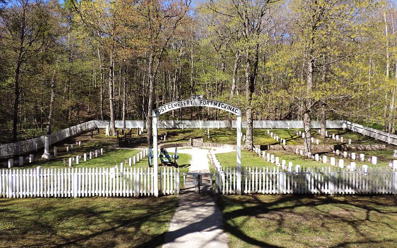 US Post Cemetery picket fence, arched sign and turnstyle