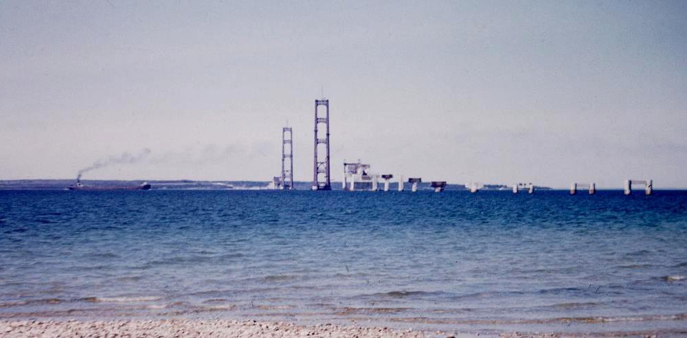 freighter and Mackinac Bridge construction